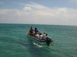 Taking smaller boat to tour Northern Caye