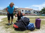 Heather and Cathy with donations and luggage