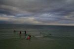 boys surfing in belize at banyan bay belize beach resort
