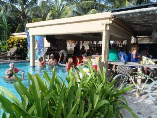 coco locos beach bar with swim up pool bar