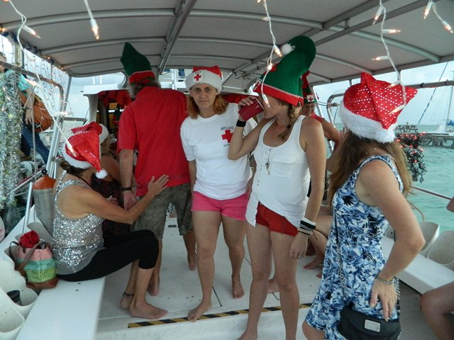 belize red cross party for 2014 san pedro lighted boat parade